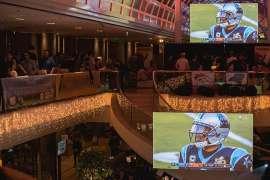 Superbowl Party mit Riesenvideoscreens in der großen Atriumhalle des Vienna Marriott