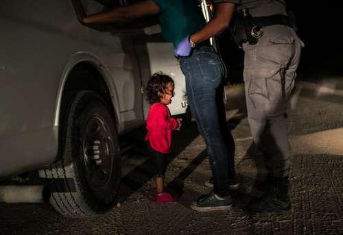 John Moore: Crying Girl on the Border